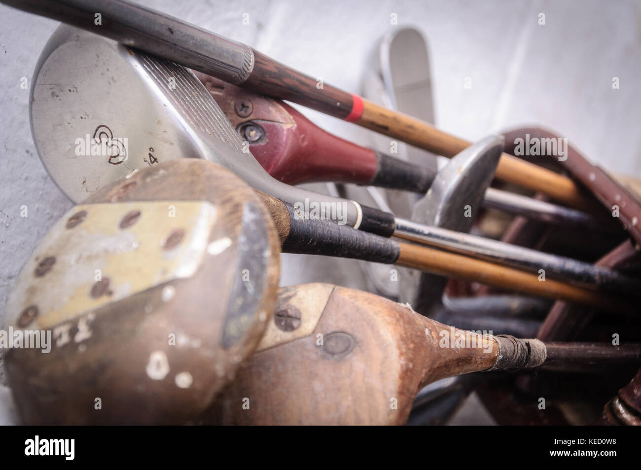Vintage worn out golf clubs retired from use - Stock Image