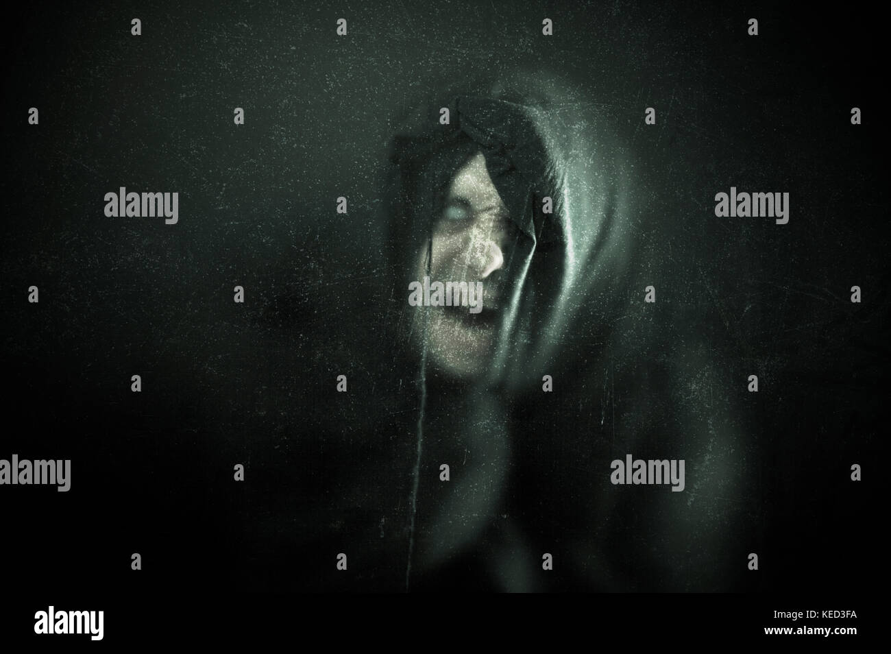 Angry ghost figure in the dark - Stock Image