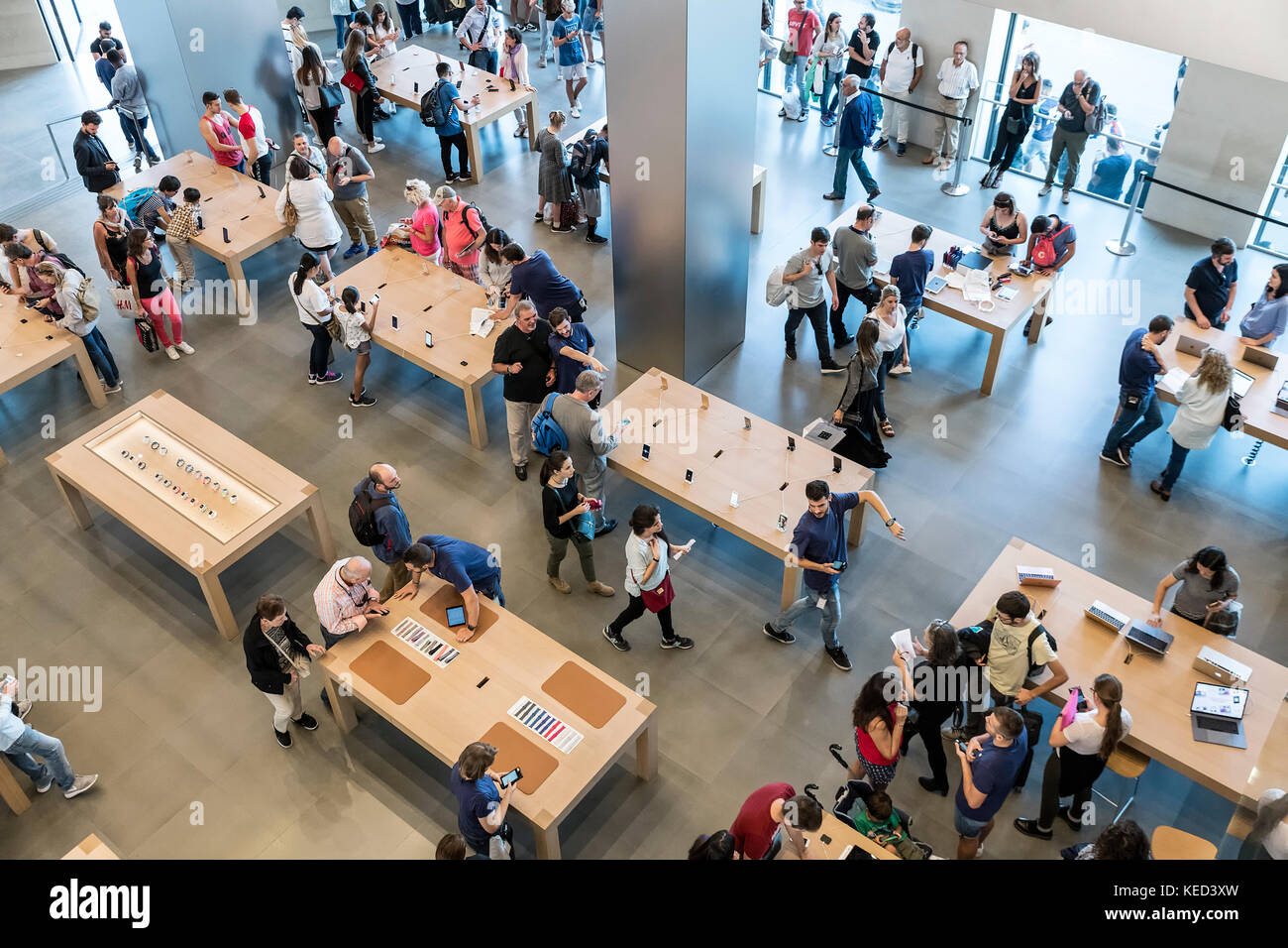 Interior  of busy Apple flagship store in Barcelona, Spain. - Stock Image