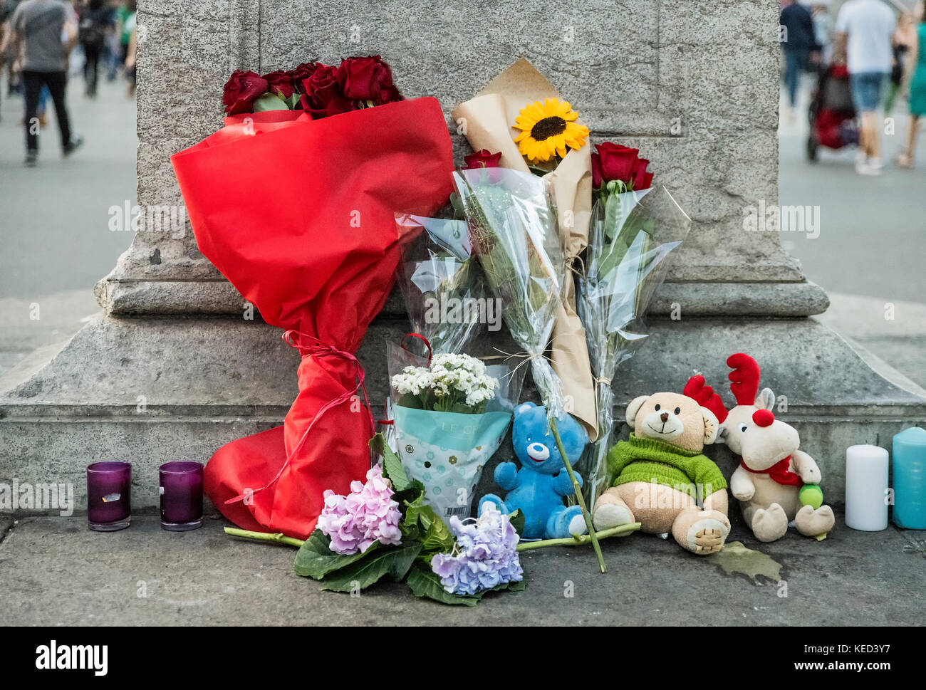 Memorial tribute flowers and candles placed at Las Ramblas district, site of a 2017 terror attack that killed 13 - Stock Image