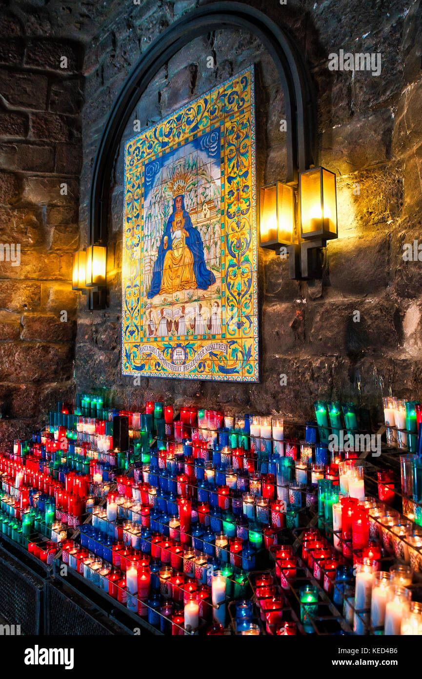 Votive candles to an icon of Santa Maria de Montserrat Abbey, Monistrol de Montserrat,  Catalonia, Spain. - Stock Image