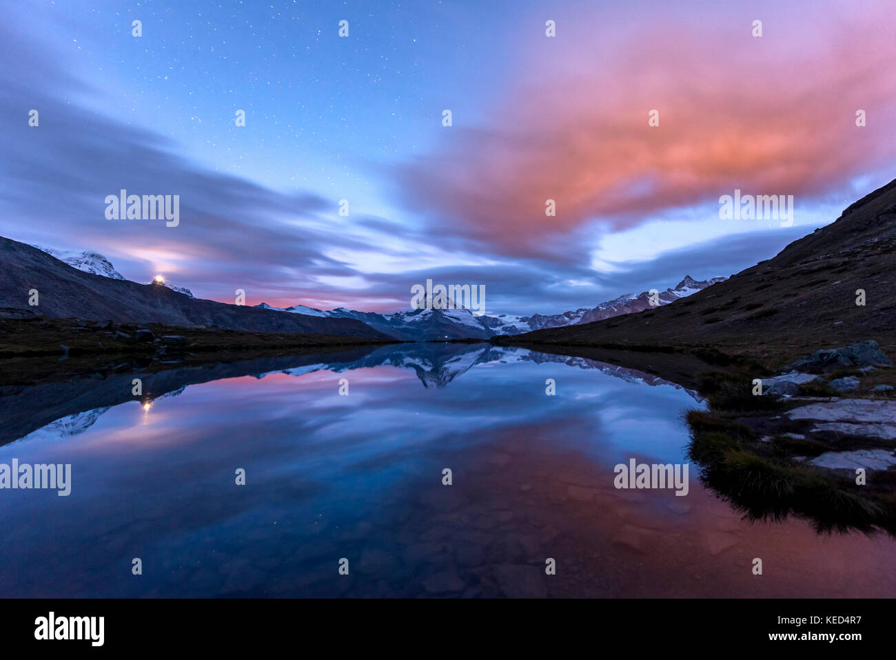 Night view, starry sky, snow-covered Matterhorn reflected in the Sellisee, Valais, Switzerland - Stock Image