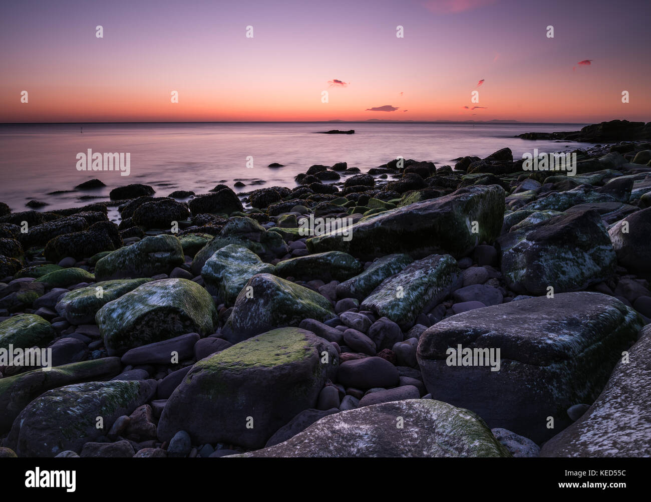 Some stunning colour as dusk falls on the Cumbrian coast - Stock Image