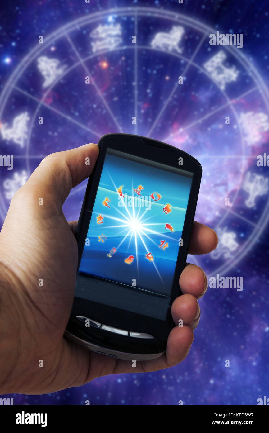 astrology online with mobile phone concept Stock Photo