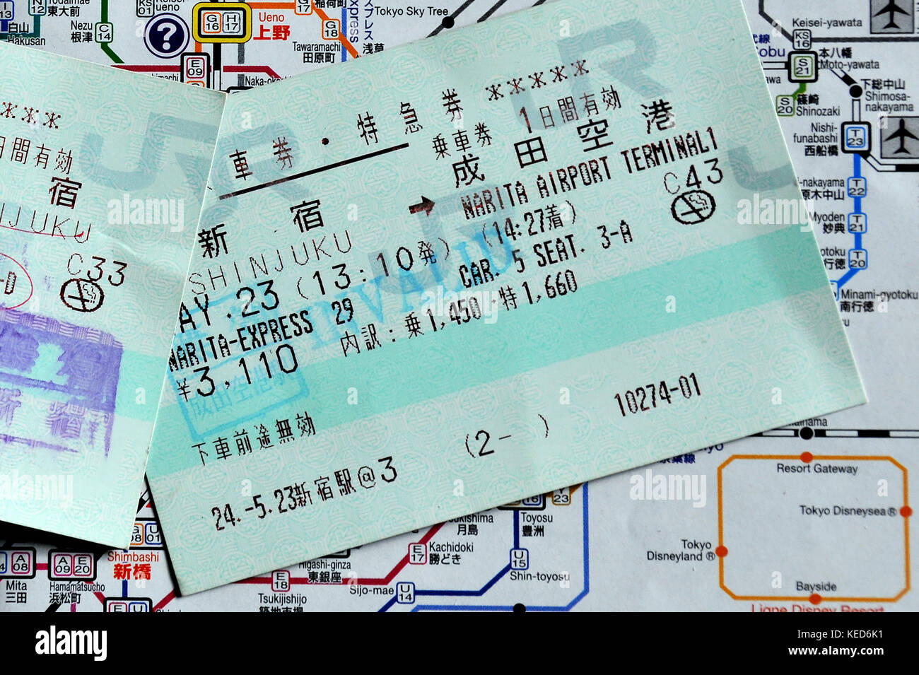 train ticket on map, Japan - Stock Image