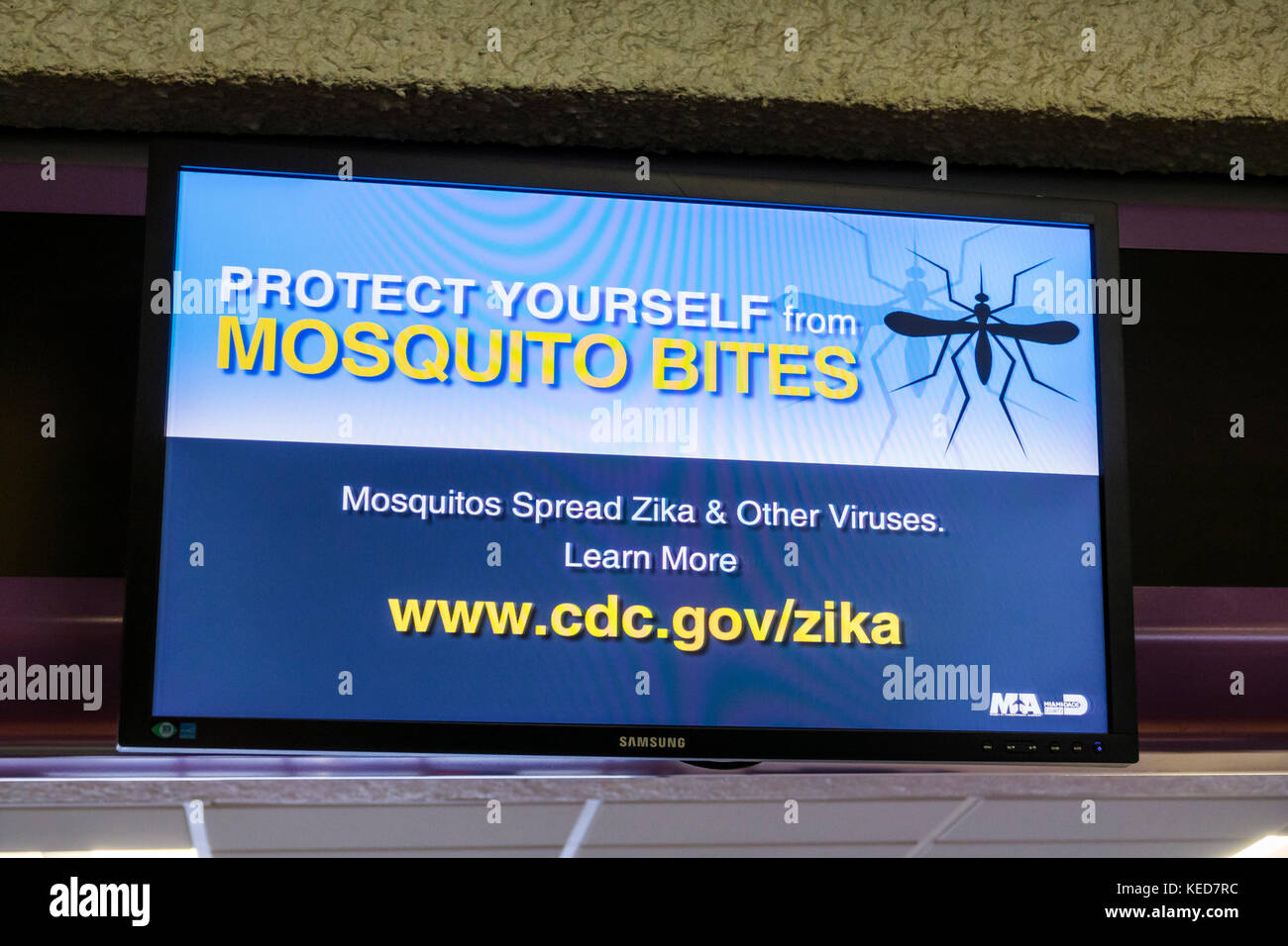 Miami Florida MIA Miami International Airport terminal information health warning digital display Zika prevention - Stock Image