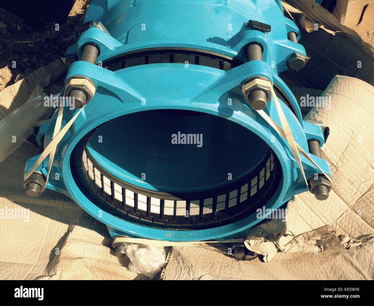 Detail of sealing system in  waga multi joint member. New spare parts for repairing of  piping in paper cover. Drink - Stock Image