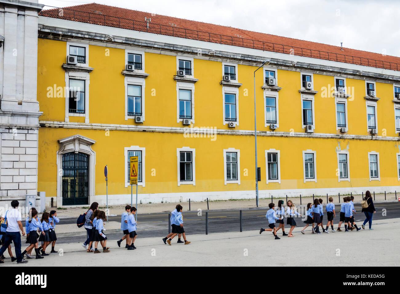Lisbon Portugal Baixa Pombalina Terreiro do Paco Praca do Comercio Commerce Square plaza school children uniform - Stock Image