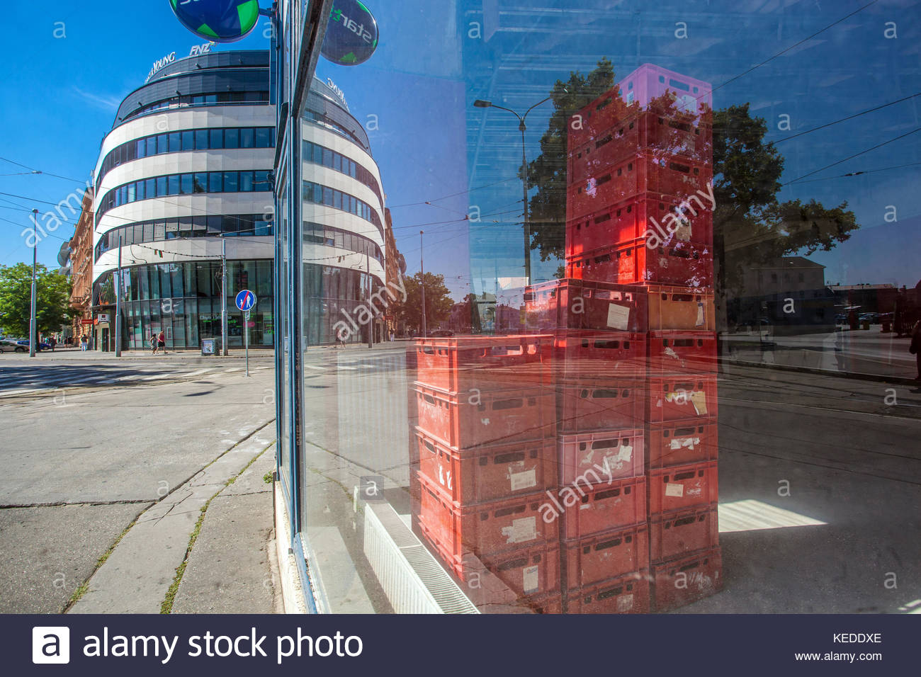 Street view on Benesova street, Modern building and red crates in empty store, Brno, Czech Republic - Stock Image