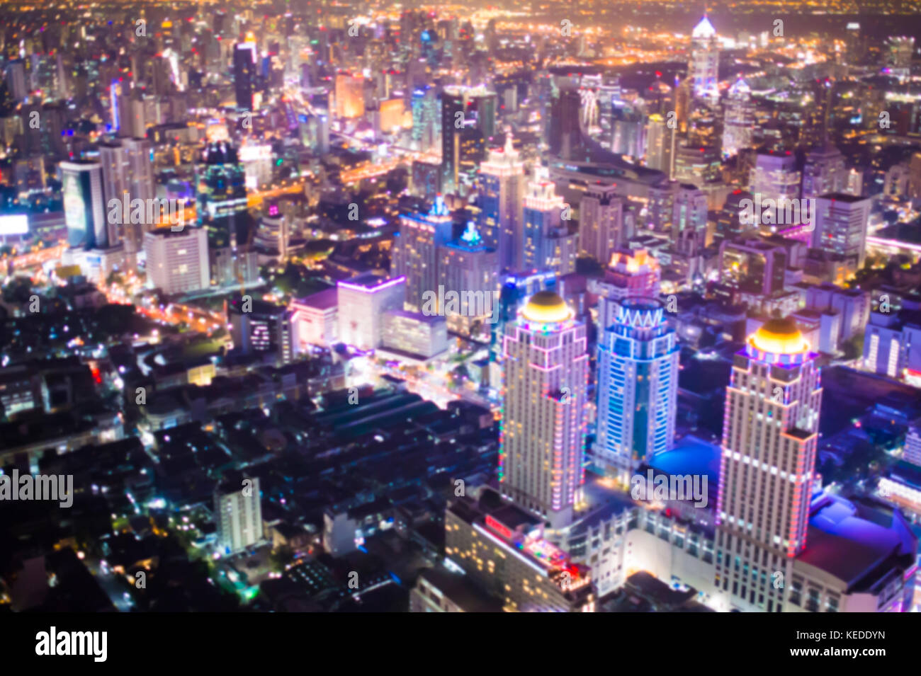 Blurred aerial view of Bangkok city at night. One of the most illuminated metropolis of Asia. - Stock Image