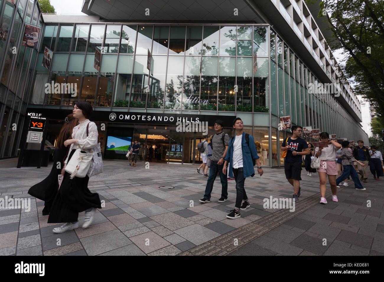 Shopper walk in front of Omotesando Hills in Omotesando, Tokyo, Japan Friday September 15th 2017 - Stock Image