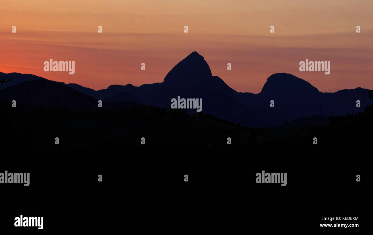 Panoramic view of Mountains of Itaipava, Petropolis, Rio de Janeiro, Brazil, in the sunrise, displaying warm colors - Stock Image