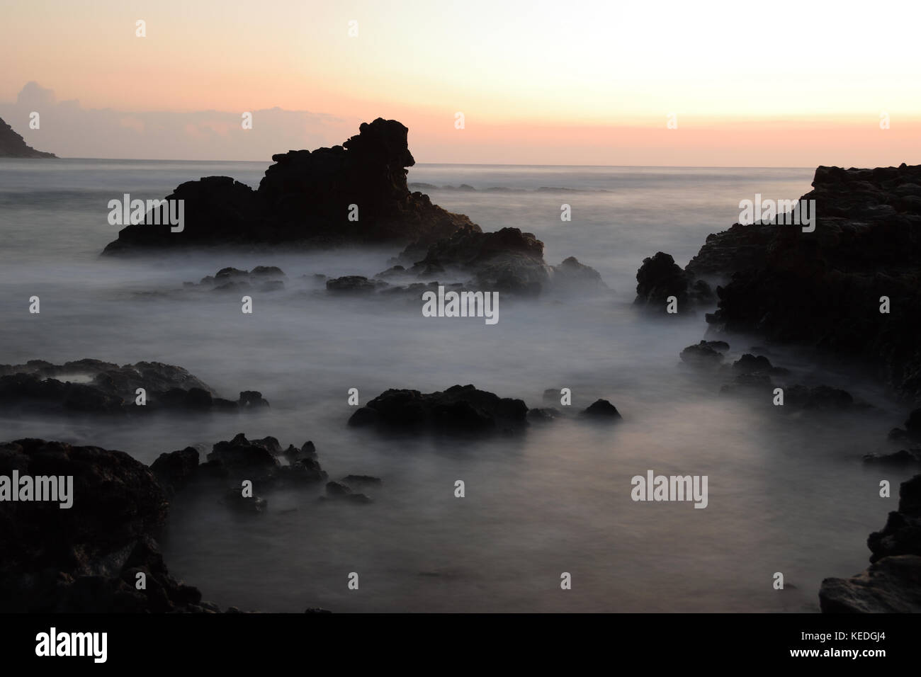 Sunrise photoshoot at Erma's Beach on the island of Oahu, Hawaii - Stock Image