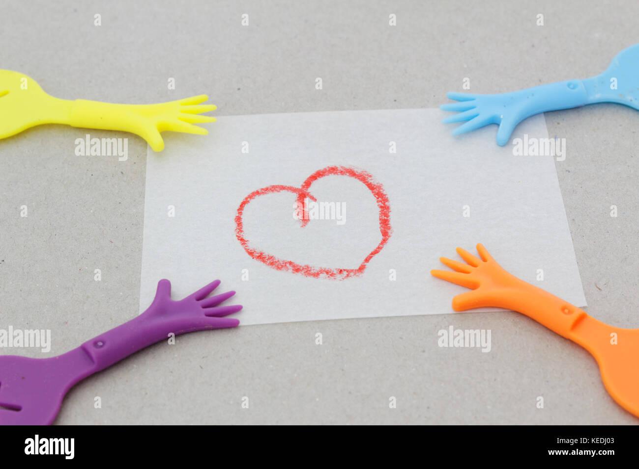 Replica of hand pulling paper with love symbol. Concept of divorce,child custody,matrinomial. - Stock Image