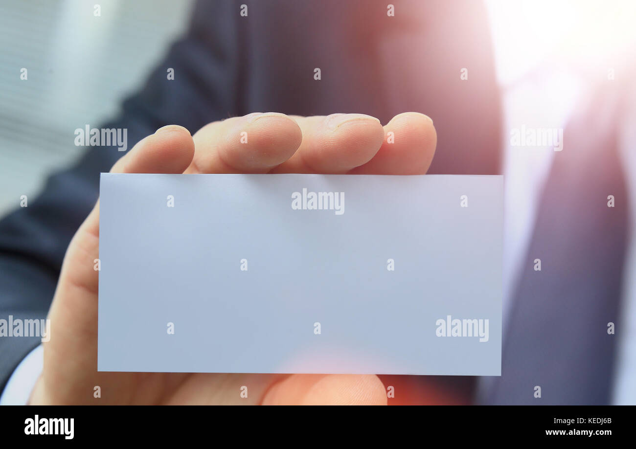 outstretched hand holding a blank business card Stock Photo ...