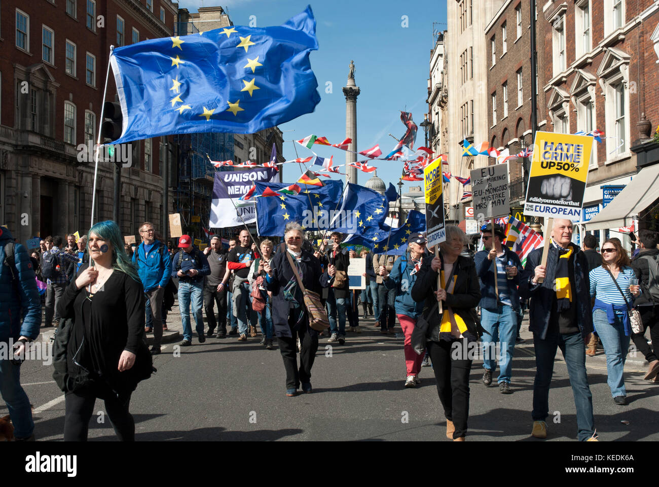 Demonstration in support of Remain/EU with many blue EU flag and poster 'Hate crime up 50% '(since Brexit - Stock Image