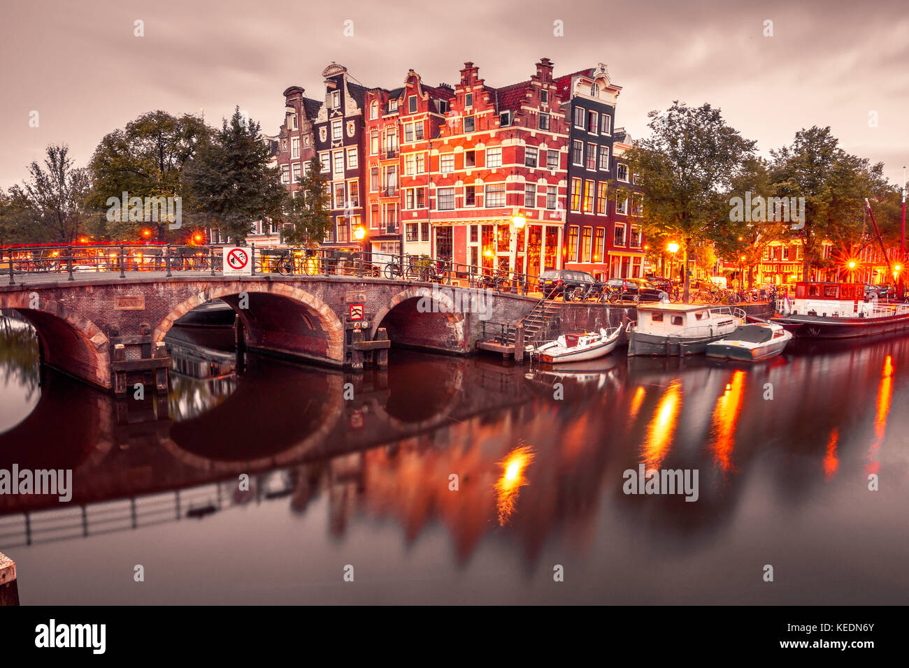 Night city view of Amsterdam canal and bridge - Stock Image