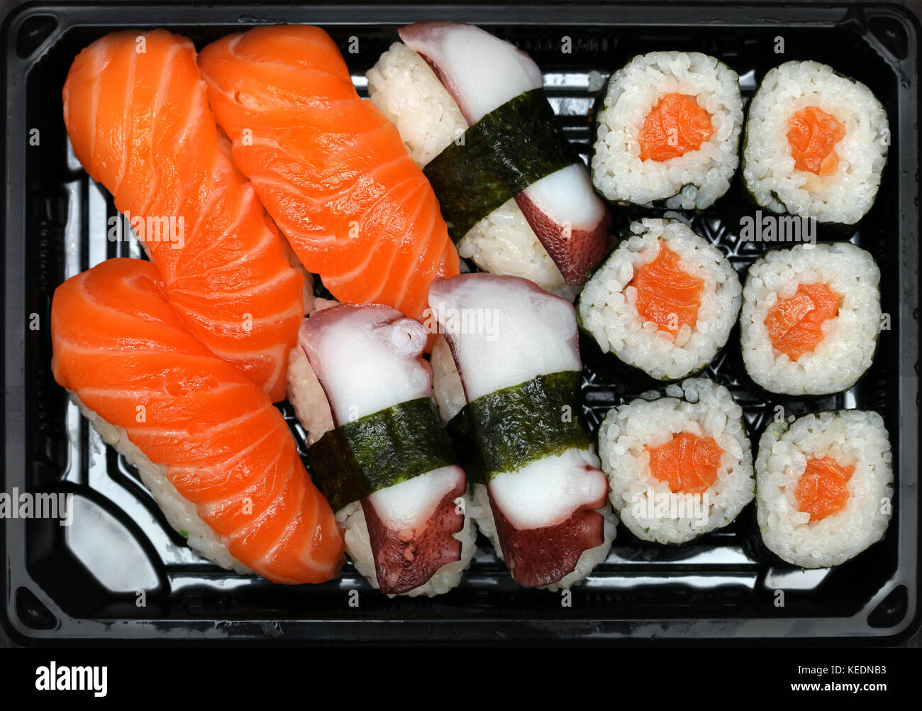 Assortment of fresh Japanese sushi with raw seefood - Stock Image