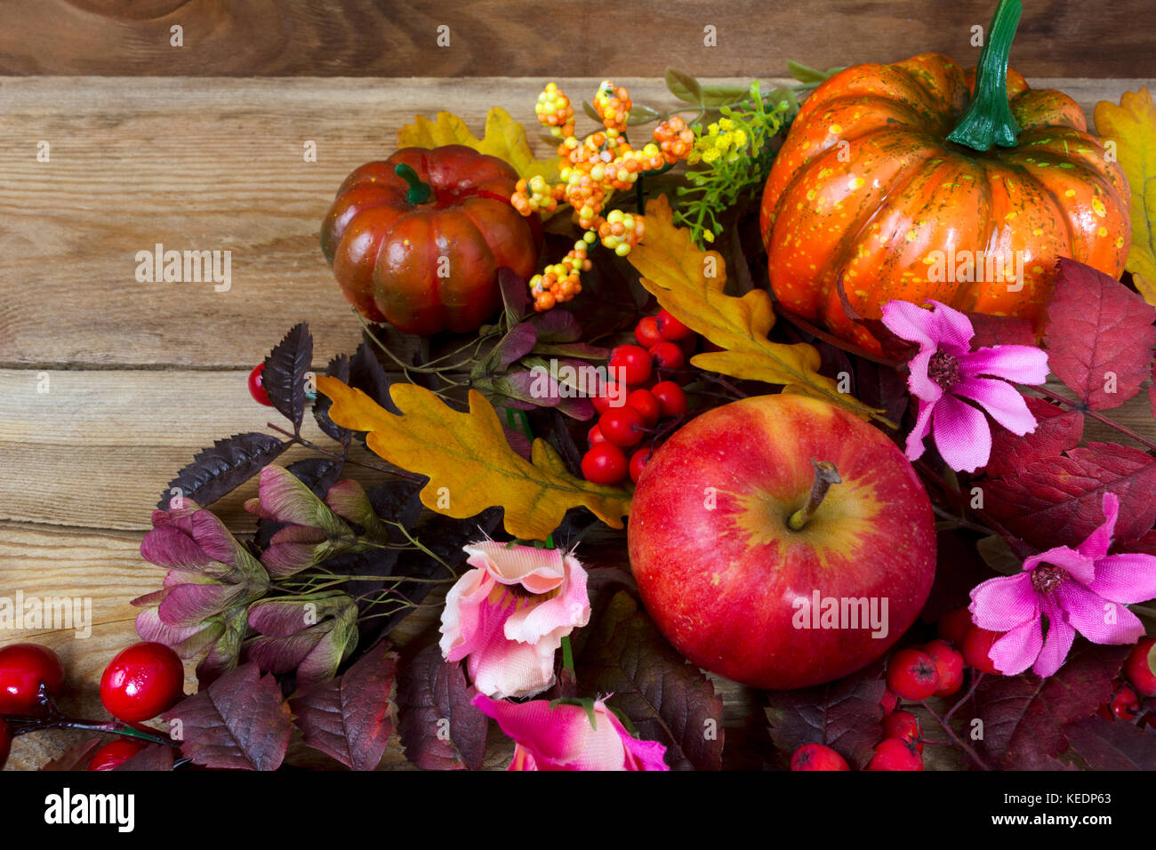Fall Rustic Background With Pumpkins Red Berries Rowan Leaves Apples Yellow And Pink Flowers