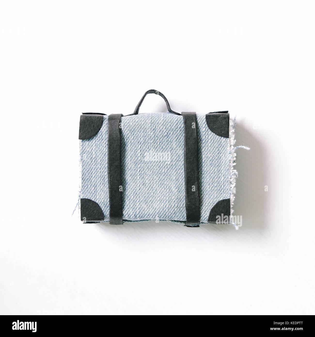 Travel suitcase on white background - Stock Image
