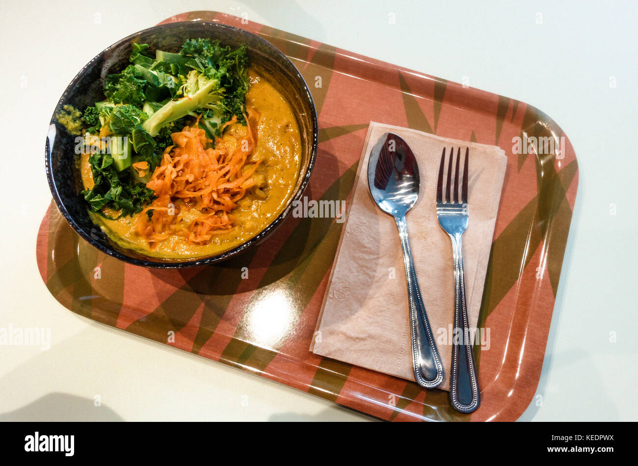 Tibetan mama, with coconut curry peanut butter sauce served over brown rice, with steamed vegetables and kimchi - Stock Image