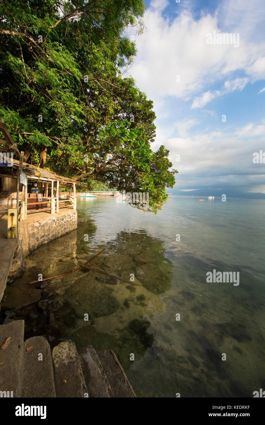Calm ocean lagoon at Bunaken Island, Sulawesi - Stock Image