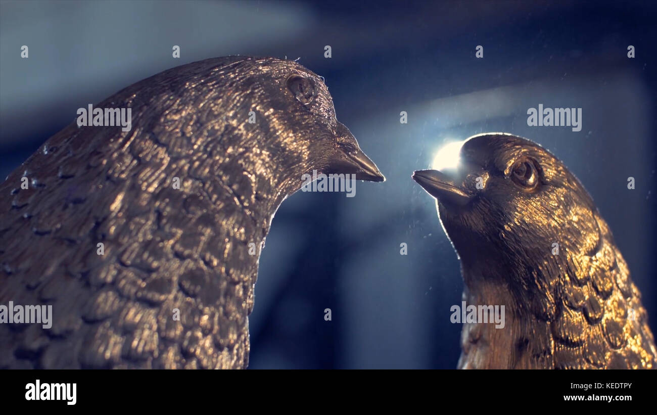 Two iron dove. Two doves forged from iron in the background shines the spotlight - Stock Image