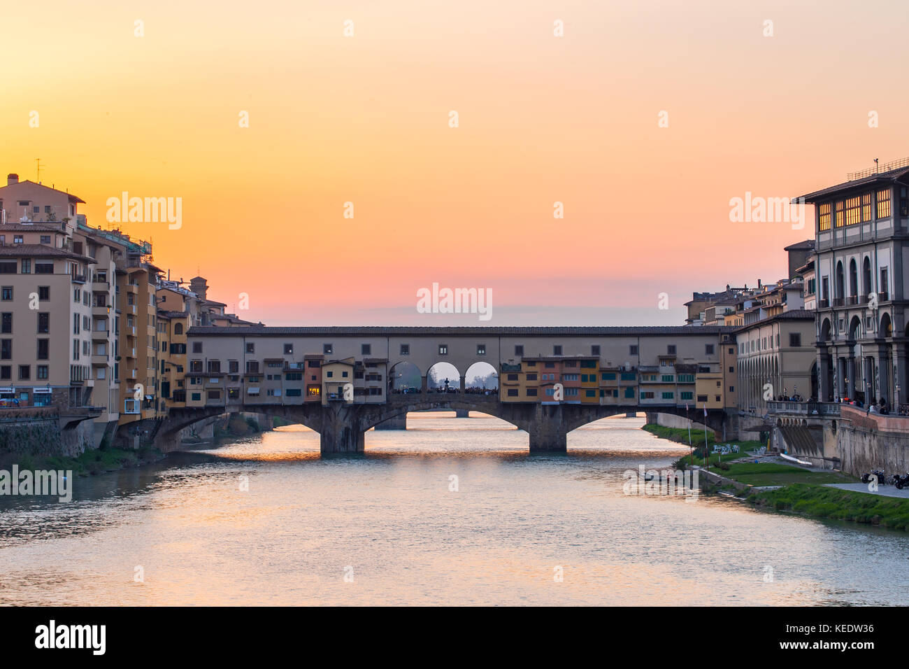 Sunset view at Ponte Vecchio the old bridge in Florence, Tuscany, Italy. - Stock Image