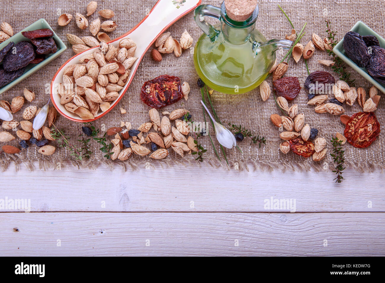 Prunes, dried apricots, raisins, almonds, dried tomatoes - handmade. Dried fruits, vegetables, nuts and butter. - Stock Image