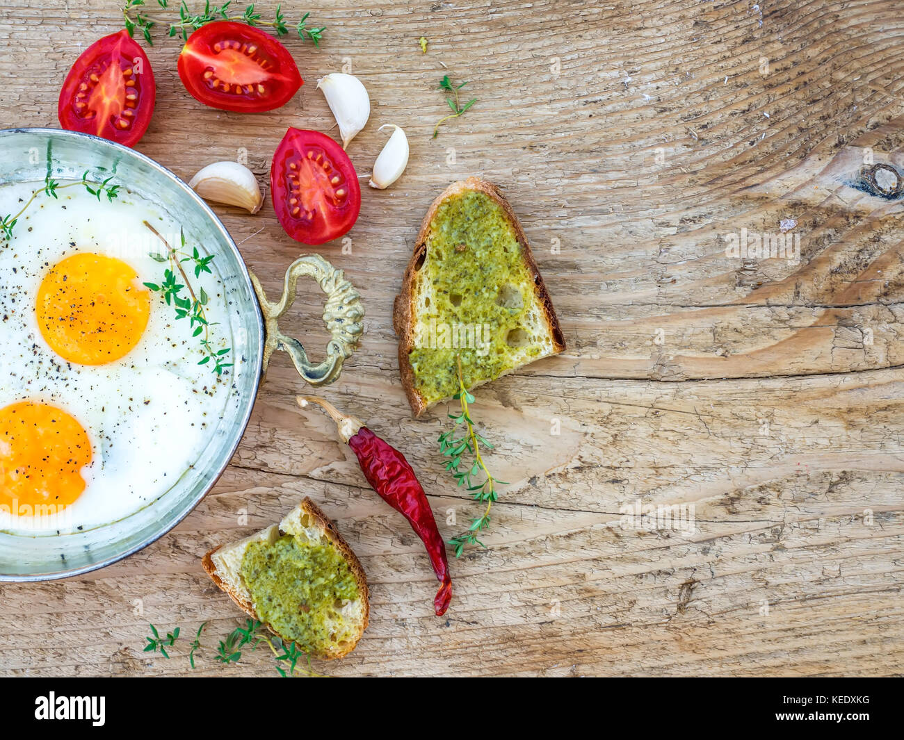 Breakfast set with fried egg on a wooden desk - Stock Image