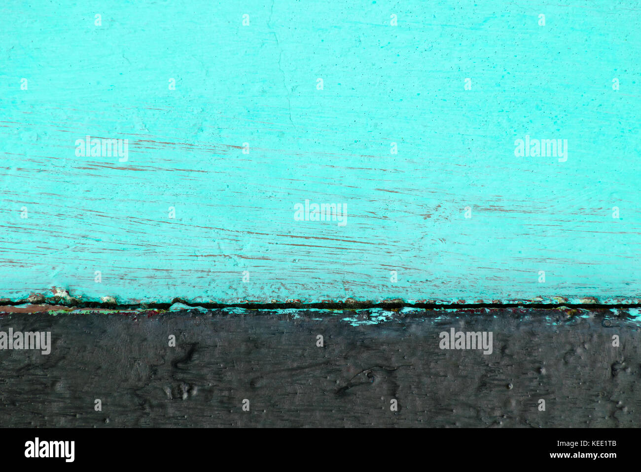 Two-tone wooden background consisting of turquoise color with black. - Stock Image