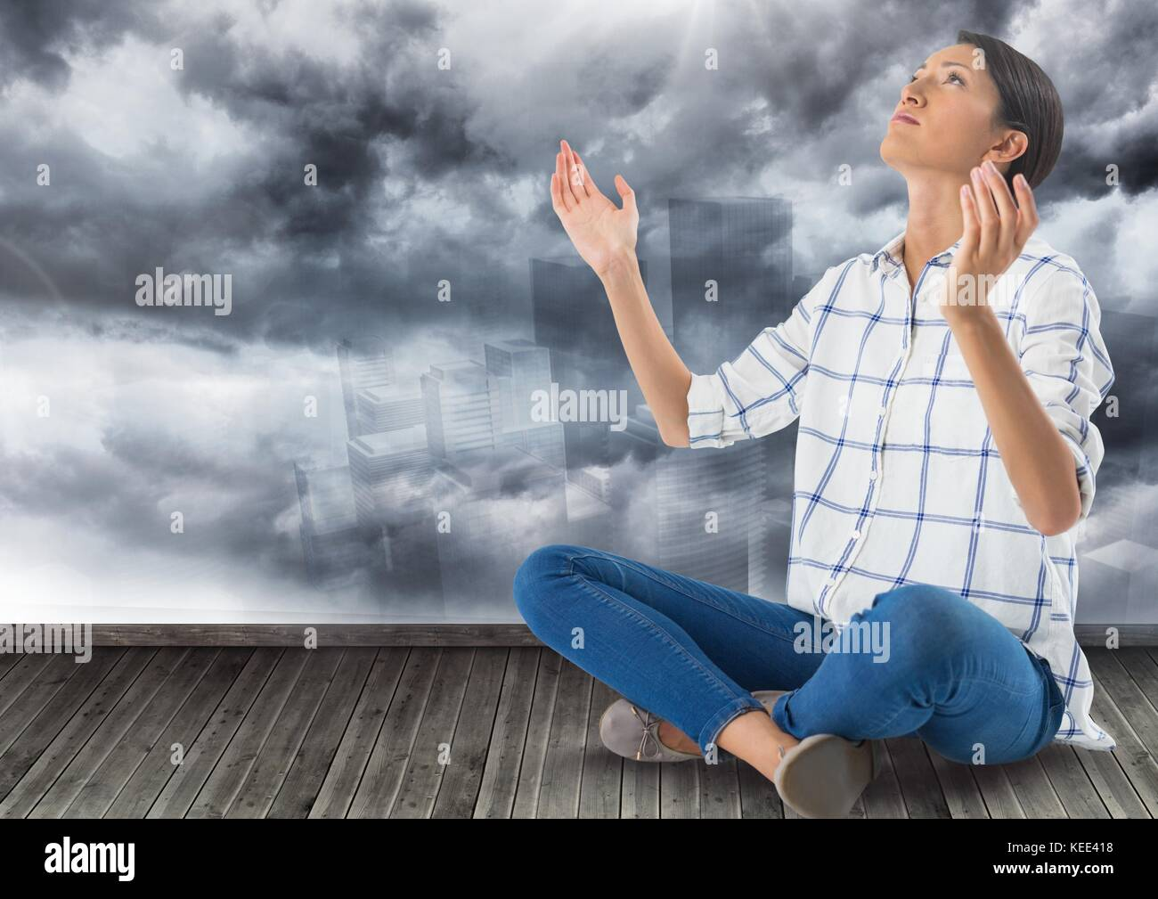 Digital composite of Woman asking hopefully to the sky - Stock Image