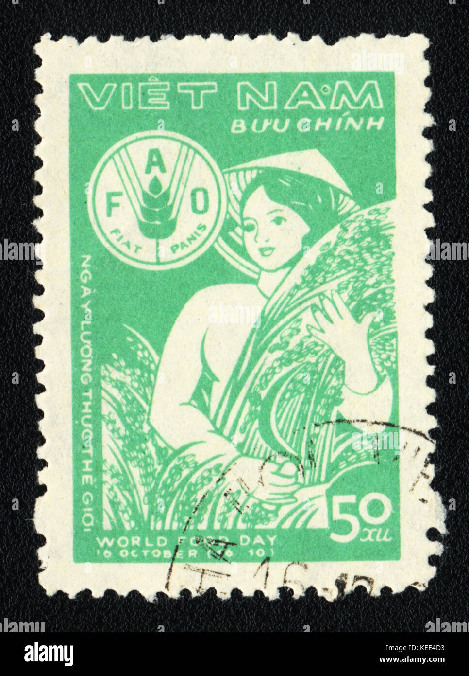 A postage stamp printed in VIETNAM  shows World food day , circa 1980 - Stock Image