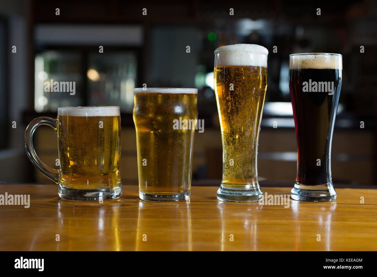 Close-up of beer glasses on the counter in bar - Stock Image