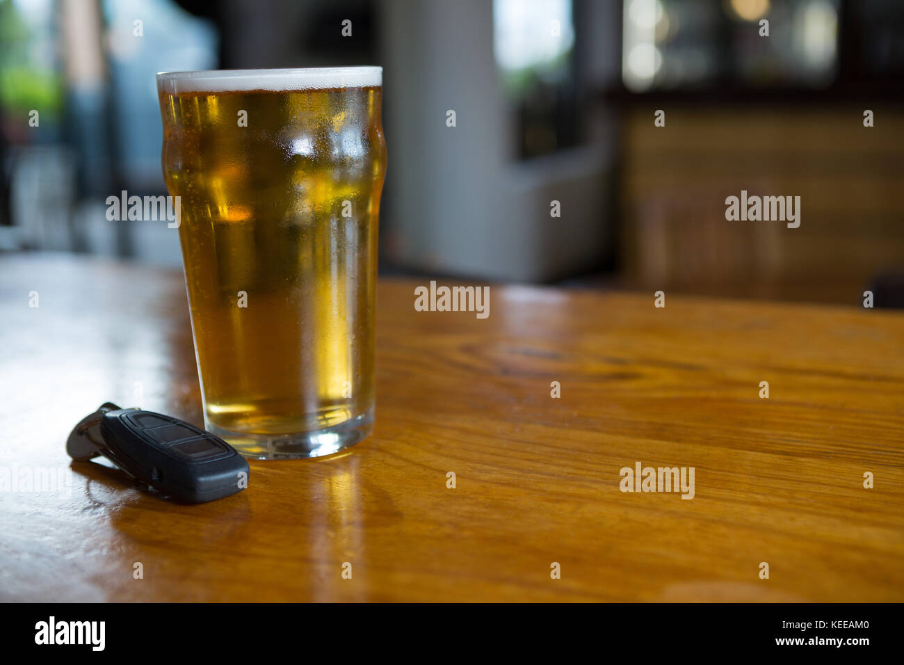 Close-up of beer glass on the counter in bar - Stock Image