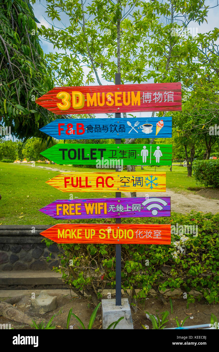 BALI, INDONESIA - MARCH 08, 2017: Informative sign in colorful arrows in a traditional balinese hindu temple Bajra - Stock Image