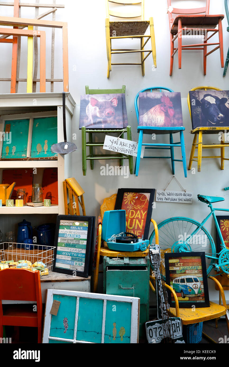 Colorful display of chairs and other stuff, Marigolds Farmhouse Funk & Junk (antiques store), Breckenridge, - Stock Image