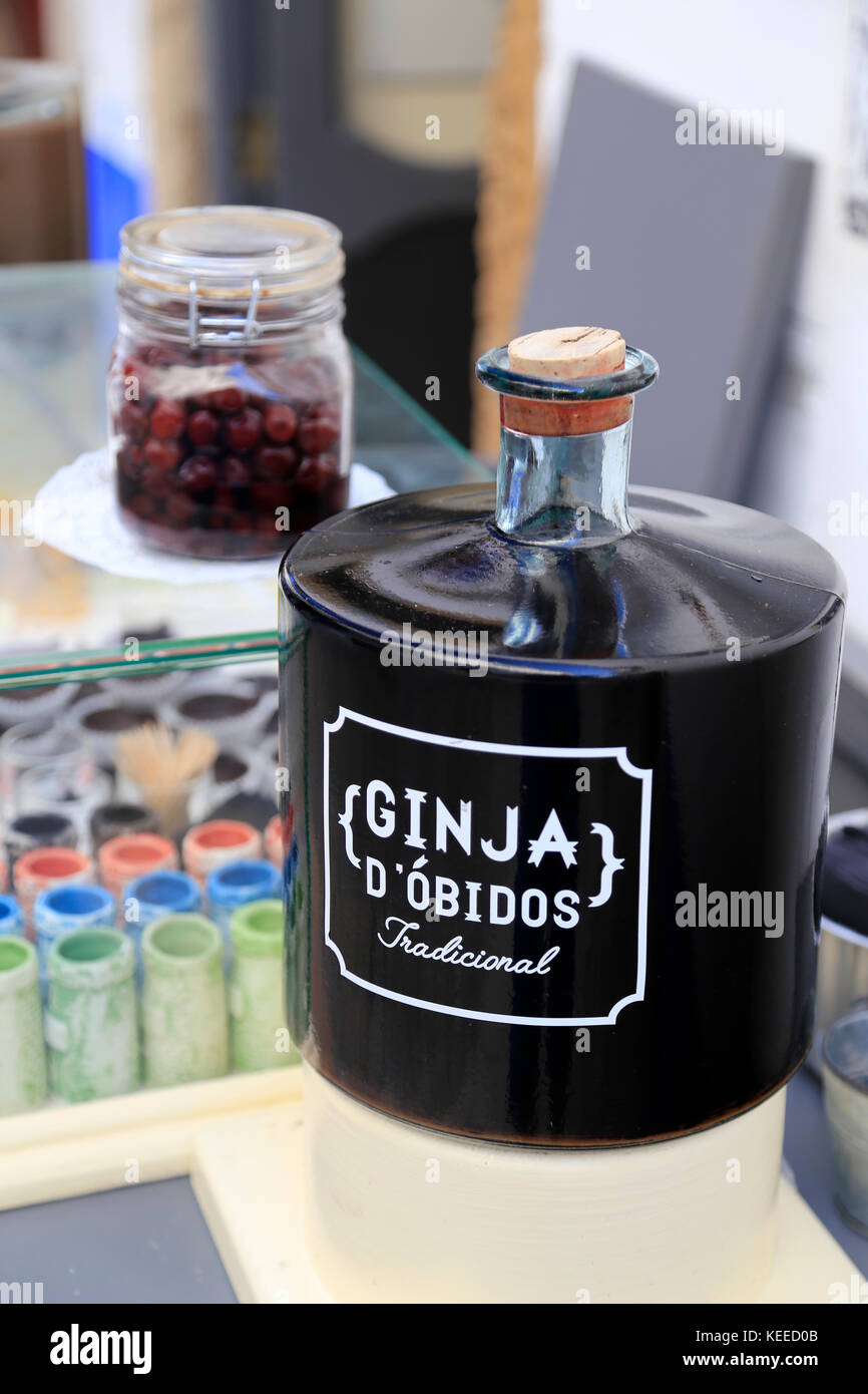 Flagon of Ginja d'Obidos - Portuguese cherry liqueur drunk in chocolate cups! Stock Photo