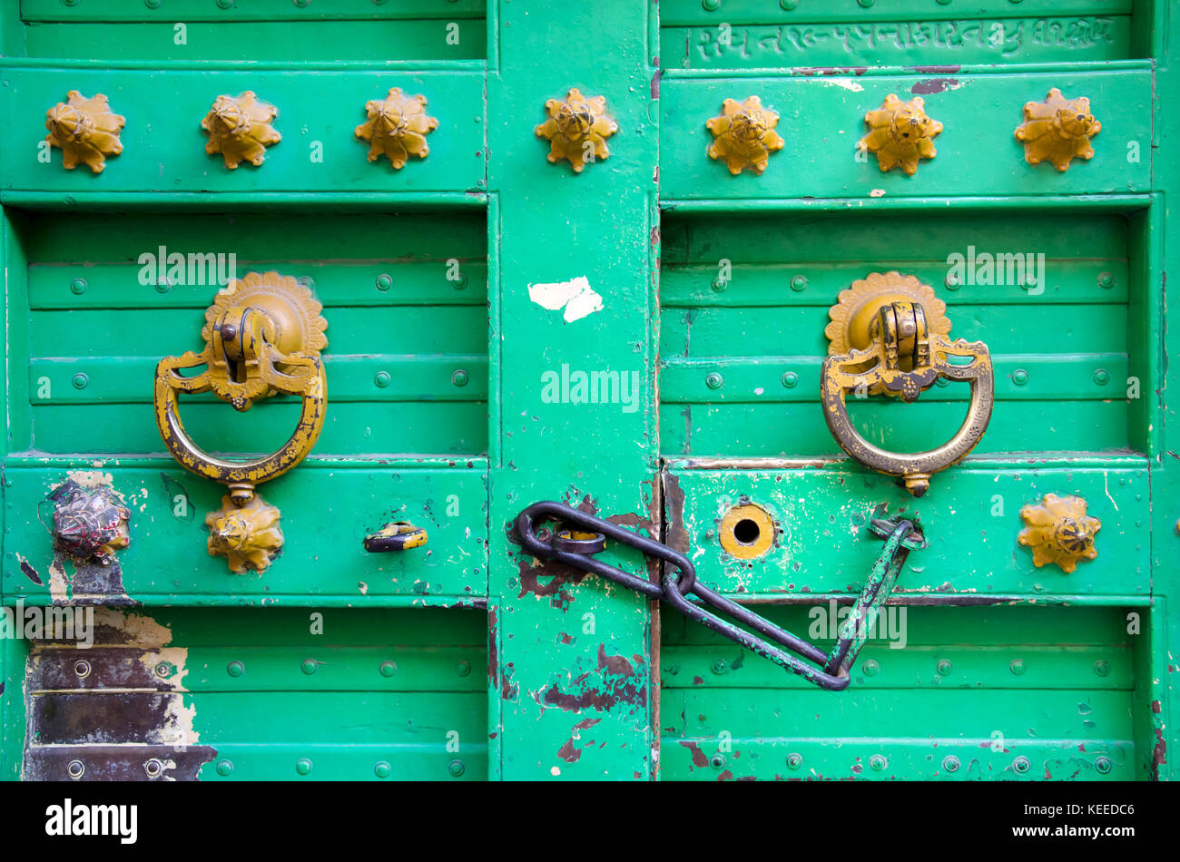 Old vintage handles and traditional wooden door of a home in the heritage city Ahmedabad, Gujarat, India - Stock Image