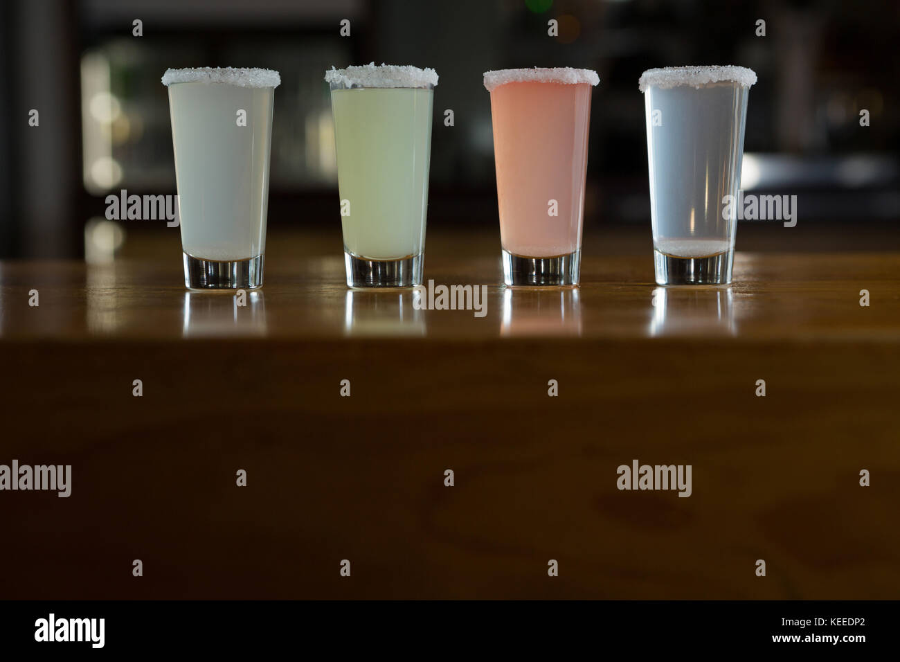 Close-up of tequila shot glasses in bar - Stock Image
