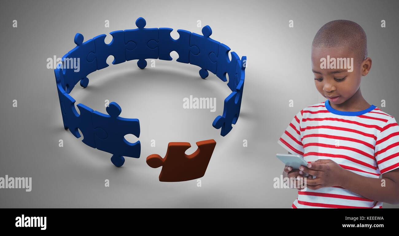 Digital composite of Boy against grey background with phone device and jigsaw puzzle pieces Stock Photo