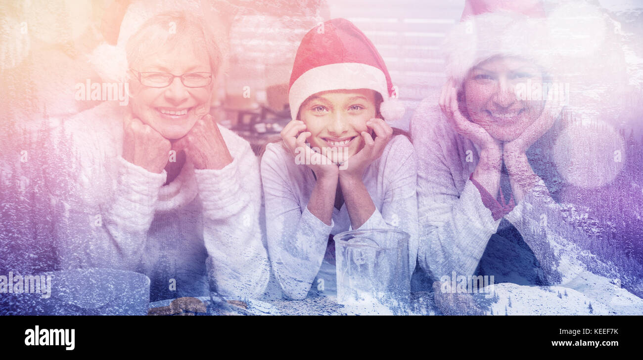 Snowy pine trees on alp mountain slope against multi-generation family baking together - Stock Image