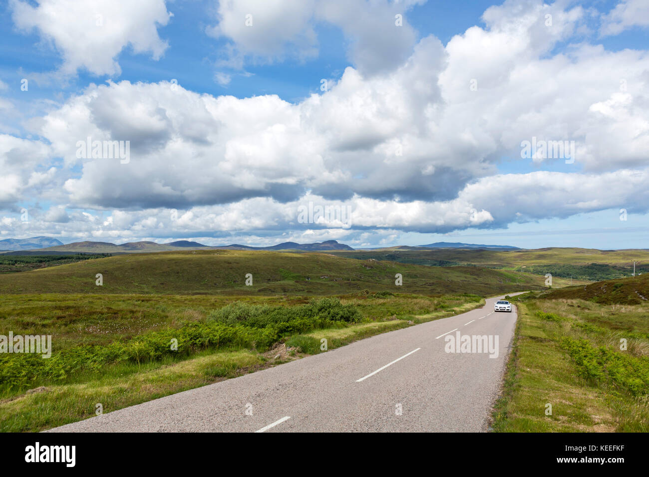 Car on the A836 near Invernaver, part of the North Coast 500 scenic route, Sutherland, Scottish Highlands, Scotland, - Stock Image