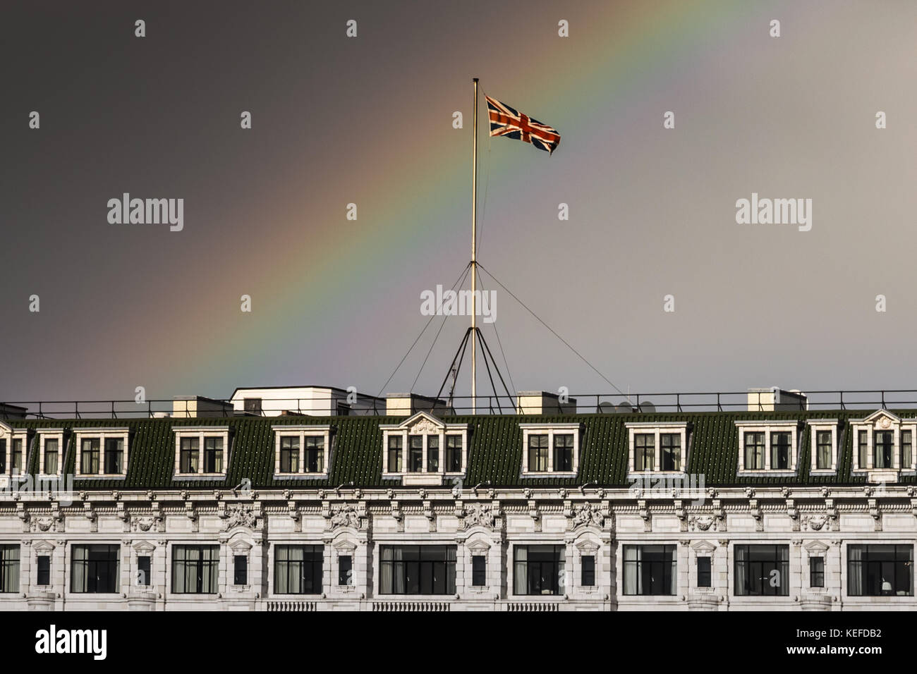 London, UK. 21st Oct, 2017. UK Weather: Storm Brian brings a rainbow over the Savoy Hotel. Credit: Guy Corbishley/Alamy - Stock Image