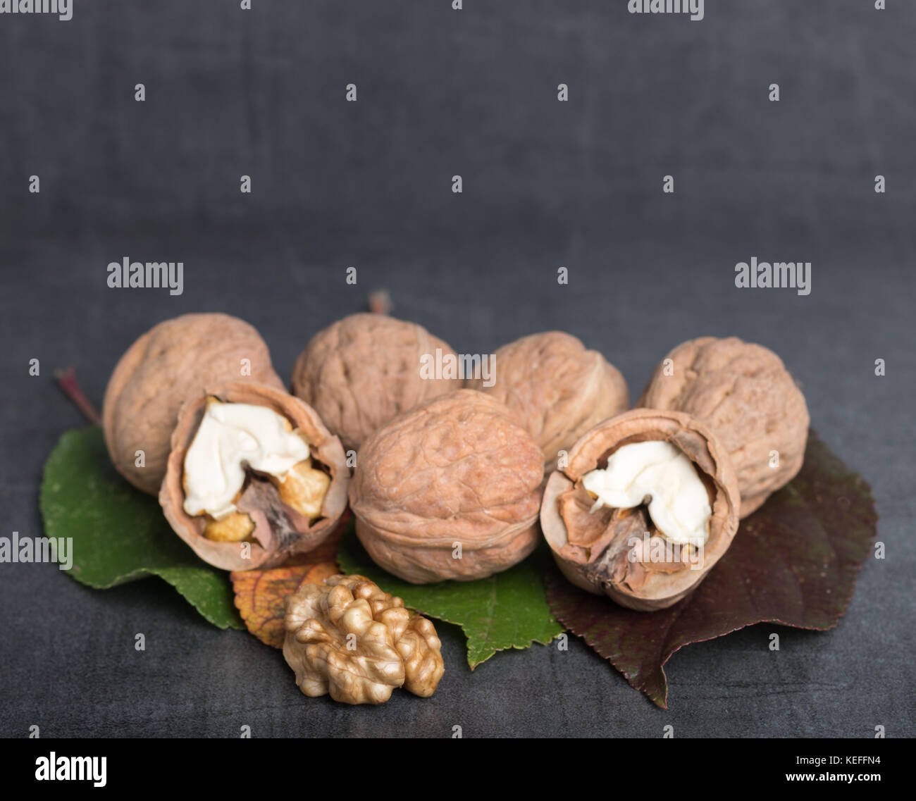 bio walnuts on a stone table - Stock Image