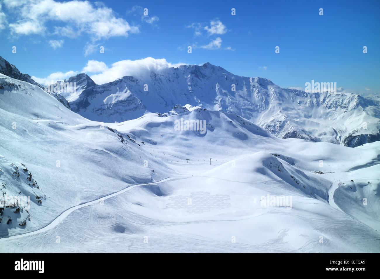 Winter mountain panorama with fresh snow on skiing tracks, Meribel slopes, 3 Valleys resort, Alps, France - Stock Image