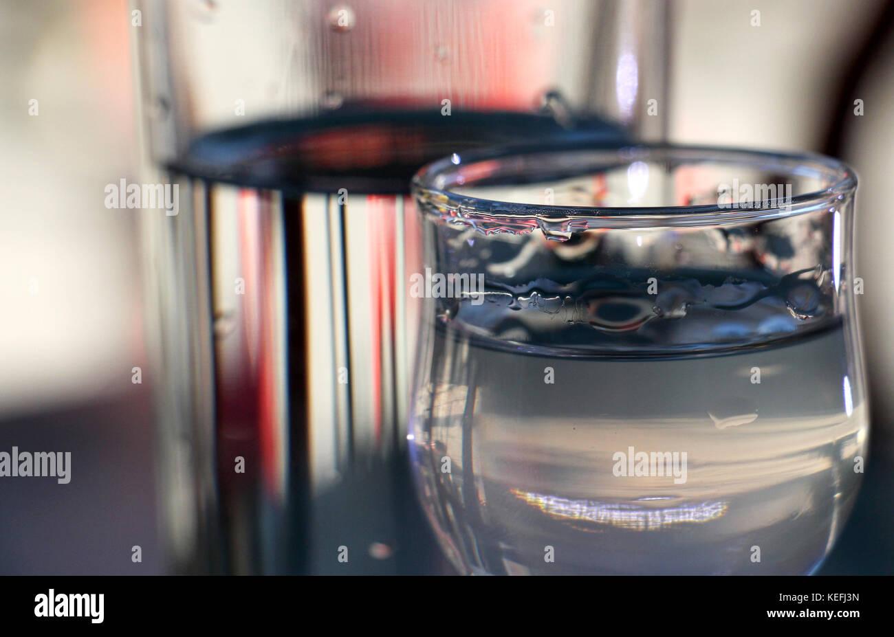 cold served macedonian rakia and glass of water , shalow dof - Stock Image