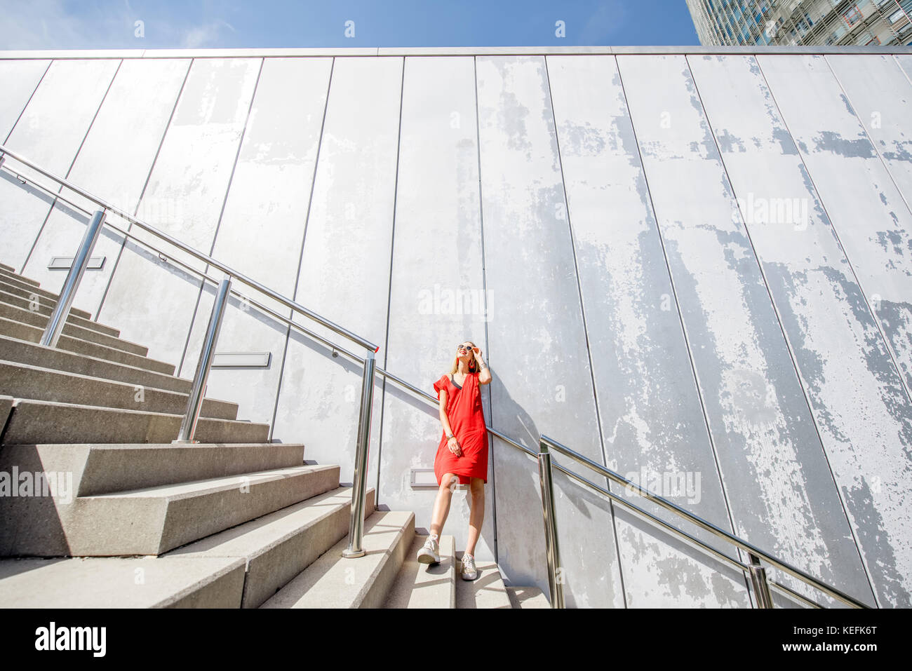 Woman on the stairs - Stock Image