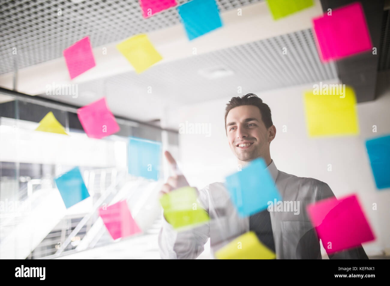 Business planning with sticker memo on glass - Stock Image