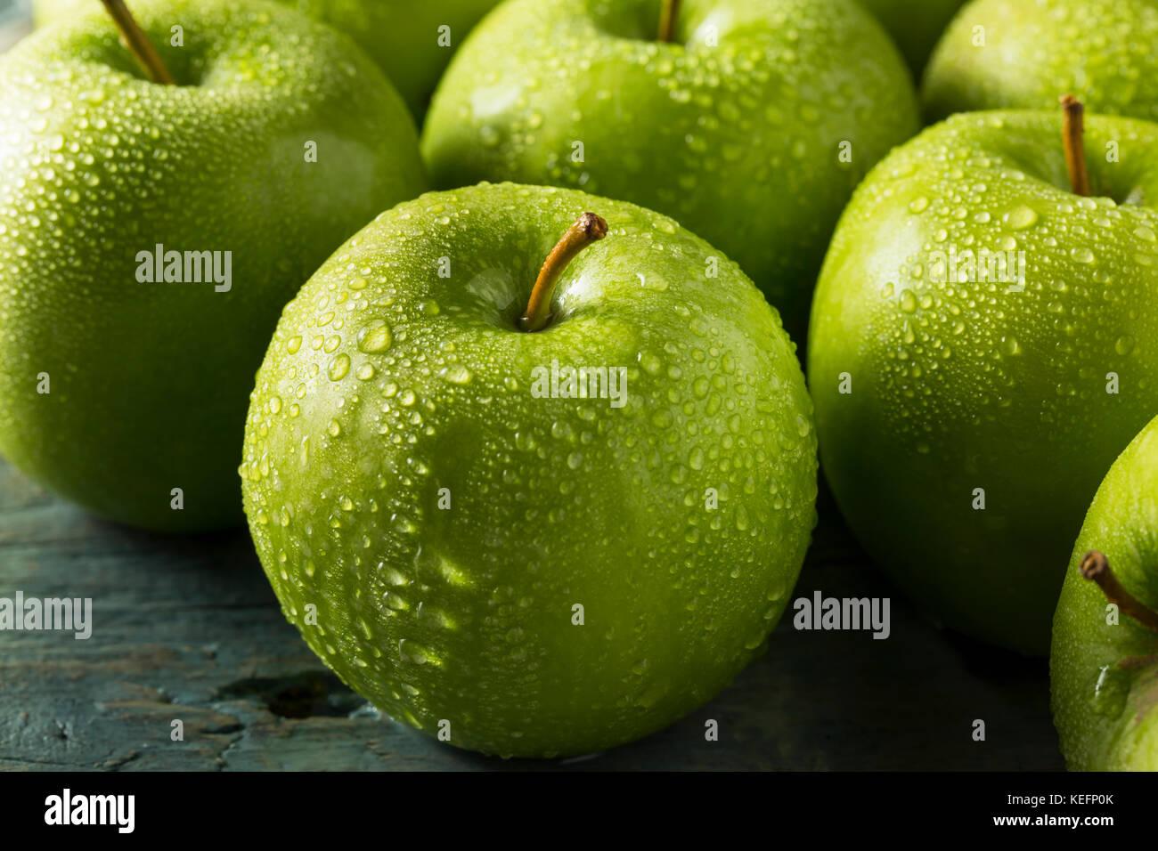 Raw Green Organic Granny Smith Apples Ready to Eat - Stock Image